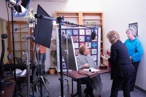 Make up artist Laura Simkins prepares Education Director Lisa Wawronzek of Alzheimer's Resource of Alaska for her interview.