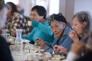 Elders are honored weekly in a luncheon attended by members of the Chickaloon Village Traditional Council (Nay'dini'aa Na') where children serve the elders first.