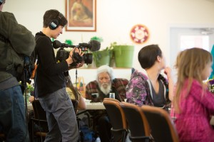 Director of Photography Nara Garber films the weekly elders and children's luncheon at Chickaloon Village Traditional Council (Nay'dini'aa Na').
